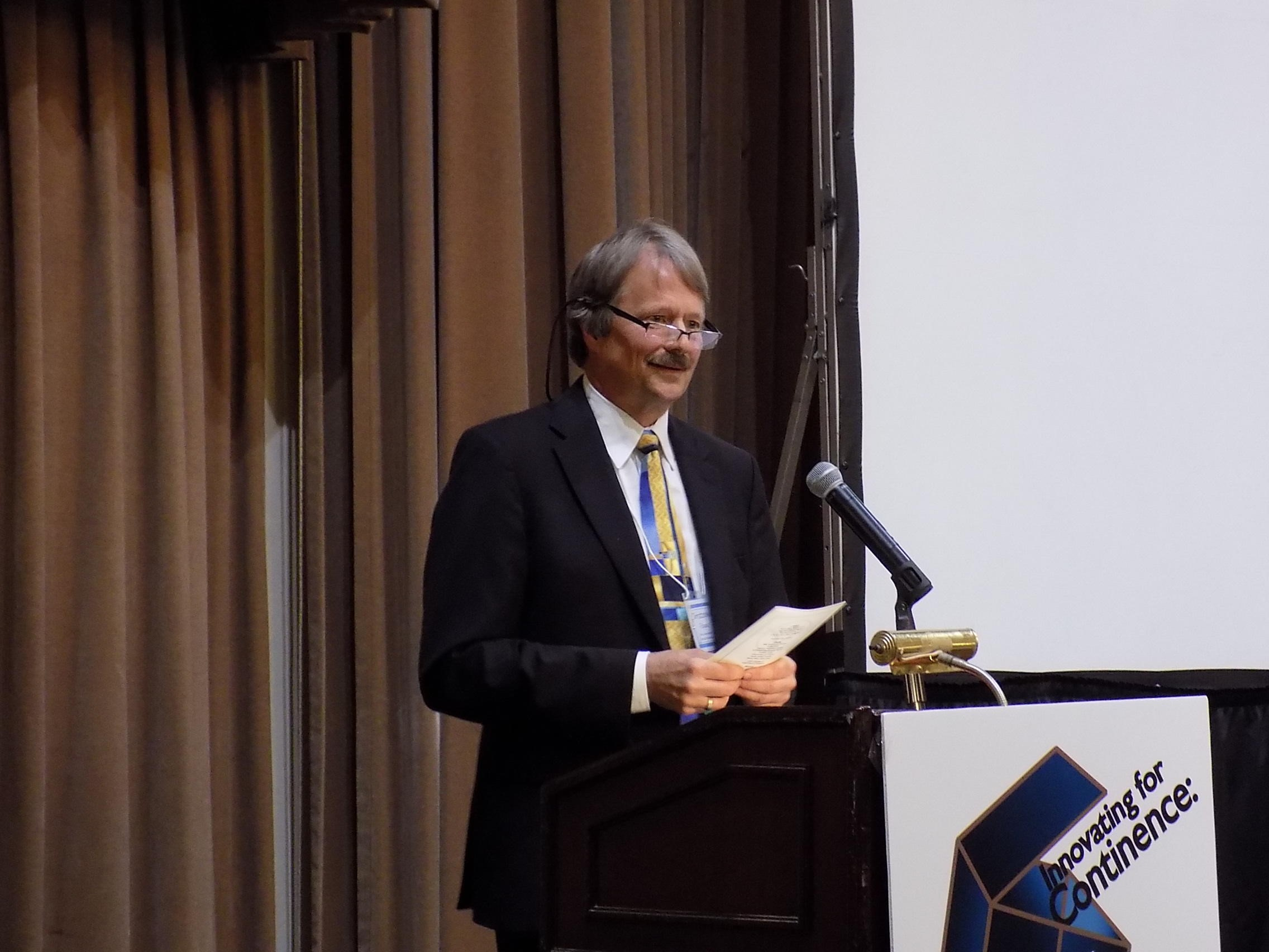 Christopher Payne, MD, announcing the two winners of the John J. Humpal Award